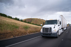 Semi trucks convoy moves interstate highway in California Stock Image