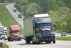 Truck traffic on the highway. Interstate truck traffic on a highway Royalty Free Stock Photo