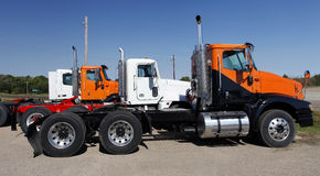 Semi Trucks in Orange and White Royalty Free Stock Image