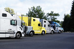 Semi-trucks parked in a rest area. Royalty Free Stock Photo