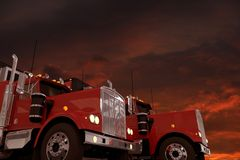 Semi Trucks and Stormy Sky Royalty Free Stock Image