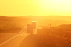 Semi trucks and sun glare. Along Trans Canada Highway Stock Photo