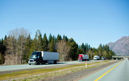 Semi trucks trucking convoy interstate highway California Royalty Free Stock Photos
