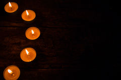 Semicircle of candles on a black Royalty Free Stock Photo
