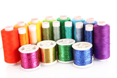 Semicircle of many-coloured bobbins of thread Stock Image