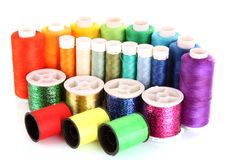 Semicircle of many-coloured bobbins of thread Stock Images