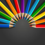 Semicircle of rainbow colored pencils with Royalty Free Stock Photos