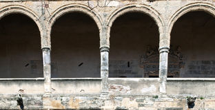 Semicircular arches. Castilian with gargoyles in the lower Stock Photo