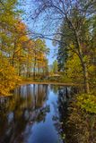 Bridge across the canal in the autumn park Royalty Free Stock Image