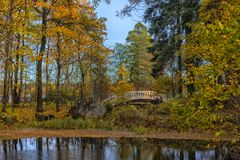 Bridge across the canal in the autumn Park Royalty Free Stock Photo