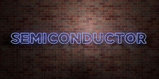 SEMICONDUCTOR - fluorescent Neon tube Sign on brickwork - Front view - 3D rendered royalty free stock picture. Can be used for online banner ads and direct Royalty Free Stock Photos