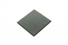 Semiconductor on a white background. One BGA package type microprosessor upside down on a white background. Visible BGA balls Stock Photos