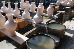 Semifinished porcelain vase. In row Stock Photo