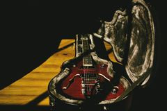 Semihollow guitar in the shadows royalty free stock images