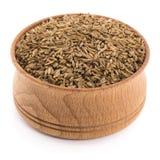 Semillas de alcaravea en un cuenco de madera Fotografía de archivo libre de regalías