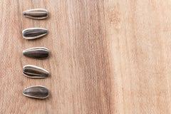 Semillas de girasol en de madera Imagen de archivo