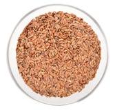 Semillas de lino de brown en el cuenco de madera aislado - Bol de vidrio ...