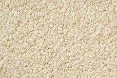 Semillas de sésamo peladas blancas cerca para arriba, fondo foto de archivo