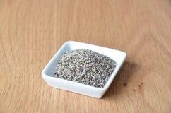 Semillas sanas del chia en blanco Alimento sin procesar Alimento biológico Imagen de archivo libre de regalías