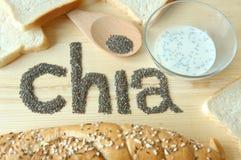 Semillas y panes de Chia con el fondo de madera Fotos de archivo libres de regalías