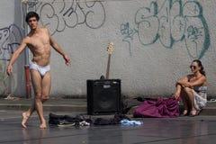 Seminaked street performer Royalty Free Stock Image