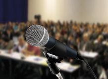 At seminar. Image of microphone at a seminar hall Royalty Free Stock Images