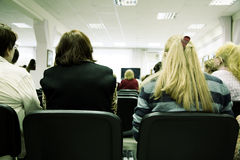 Seminar. Toned photo f/x, focus point on nearest people (selective Royalty Free Stock Photos
