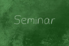 Seminar on a blackboard Stock Photography