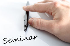 Seminar Concept. Pen in the hand  over white background seminar concept Royalty Free Stock Image