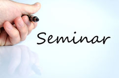 Seminar Concept. Pen in the hand  over white background seminar concept Royalty Free Stock Images