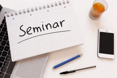 Seminar. Handwritten text in a notebook on a desk - 3d render illustration Stock Images