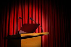Seminar podium and red curtain