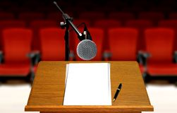 Seminar preparation with microphone and podium. With red seats royalty free stock image