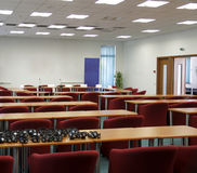 Seminar room. With red armchairs and desks Royalty Free Stock Photos