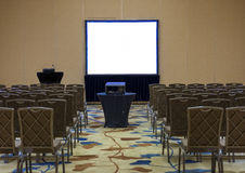 Seminar Room. Empty seminar room with blank projector screen Royalty Free Stock Photos