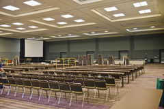 Seminar room. A seminar room set-up with rows of chairs. A projection screen is on the side. Taken in the Orange County Convention Center in Orlando, Florida royalty free stock photo