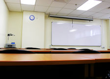 Seminar room set up. College class room empty -An image showing the interior of a classroom seminar room in a university school.  With clean, light green walls Royalty Free Stock Photo