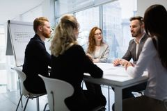 Seminars and business meetings in company office. Colleagues attending seminars and business meetings in company office Royalty Free Stock Images