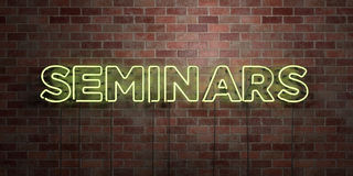 SEMINARS - fluorescent Neon tube Sign on brickwork - Front view - 3D rendered royalty free stock picture. Can be used for online banner ads and direct mailers Stock Image
