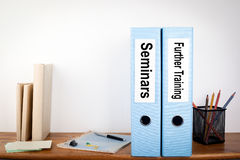 Seminars and Further Training binders in the office. Stationery on a wooden shelf.  stock image