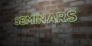 SEMINARS - Glowing Neon Sign on stonework wall - 3D rendered royalty free stock illustration. Can be used for online banner ads and direct mailers Stock Image