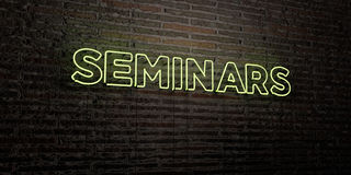 SEMINARS -Realistic Neon Sign on Brick Wall background - 3D rendered royalty free stock image Stock Photography