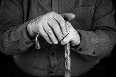 Semior's hands on cane Stock Photos