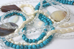 Semiprecious stones. Necklaces made of natural stone on a white background Royalty Free Stock Photography