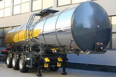 Semitrailer tank. Silver semitrailer tank parked near by factory Royalty Free Stock Image