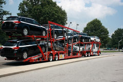 Semitrailer transporting new cars. For the company Royalty Free Stock Image