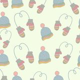 Semless hand drawn winter clothes pattern. Set. Mittens, hat, ice skates. Pastel color Stock Images