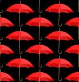 Semless um fundo dos guarda-chuvas vermelhos Imagens de Stock Royalty Free