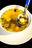 Semolina ball soup. With spoon Royalty Free Stock Photo
