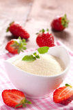 Semolina in bowl. And strawberries Stock Images